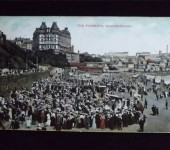 A busy Scarborough Sea Front as it was in it's Heyday. The Grand Hotel can be seen in the background.