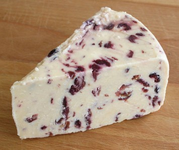 Piece of Wensleydale cheese with cranberry.