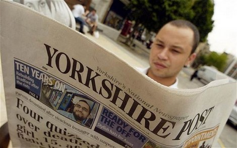 Gentleman reading the Yorkshire Post.