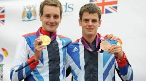 The Brownlee brothers Jonathan and Alistair showcasing their gold and bronze medals from the 2012 Olympics.