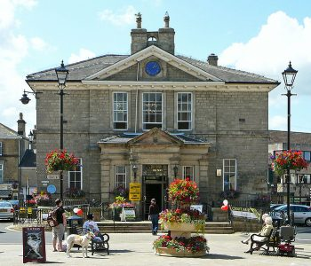 Wetherby Town Hall and one of the town's famous floral displays. Picture credit: Tim Green Wikipedia creative commons.