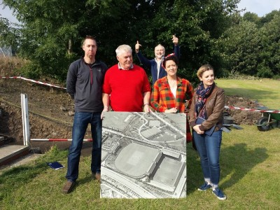 The team of archaeologists and artist hold this aerial view of the ground brought in by the Bradford Industrial museum. Picture credit: Rob Nicholls.