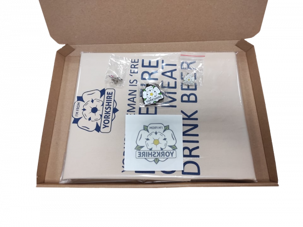 yorkshire bbq apron with a window sticker, keyring and two badges inside a gift box with a transparent background