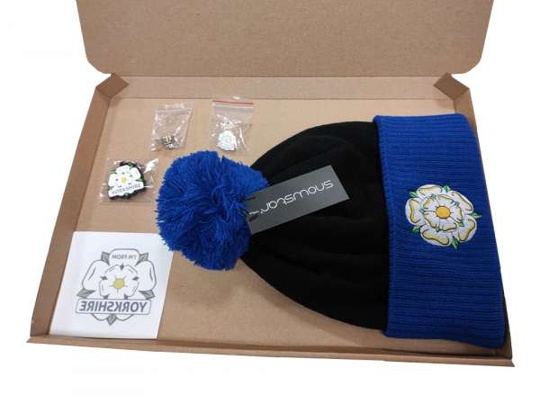 black and royal blue yorkshire rose embroidered bobble hat, yorkshire window sticker, keyring, two badges in gift box with transparent background