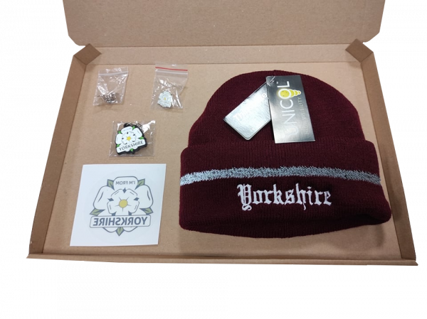 burguny yorkshire embroidered beanie, yorkshire window sticker, keyring, two badges inside gift box with transparent background
