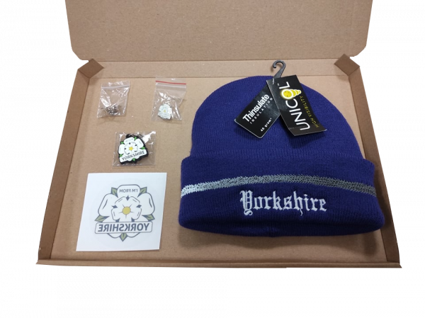purple yorkshire embroidered beanie, yorkshire window sticker, keyring, two badges inside gift box with transparent background