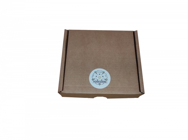 small gift box closed with ify sticker on top with transparent background