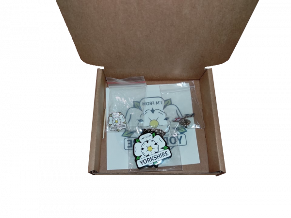 open small gift box with yorkshire window sticker, keyring, two badges inside with transparent background